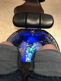 Soaking my feet! Depending on the package you purchase, they plop in some fruit and flowers.