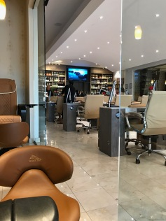 A view from my pedicure seat in the semi-private pedicure area. Yes, that's a wall of wine.